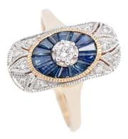 Sale 9074 - Lot 378 - A 9CT GOLD DECO STYLE SAPPHIRE AND DIAMOND RING; centring an approx. 0.08ct round brilliant cut diamond to an oval surround of taper...