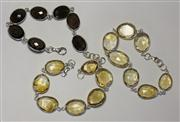 Sale 8036A - Lot 346 - A SET OF THREE STERLING SILVER GEM SET BRACELETS; 2 collet set with faceted citrines the other with smokey quartz, length 20cm