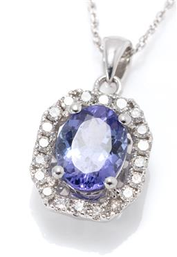 Sale 9164J - Lot 396 - A 10CT WHITE GOLD TANZANITE AND DIAMOND PENDANT NECKLAC; bead claw set with an oval cut tanzanite of approx. 1.15ct to emerald shape...