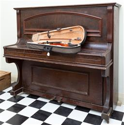 Sale 9190H - Lot 238 - An upright distressed piano together with a Ashton Violin. (damaged)