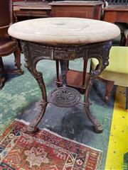 Sale 8617 - Lot 1095 - Probably Victorian Cast Iron Pub Table, marked for Caskell & Chambers Ltd. of Birmingham, with round timber top (loose) the legs wit...