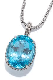 Sale 9020 - Lot 391 - A LARGE 18CT WHITE GOLD TOPAZ AND DIAMOND PENDANT NECKLACE; featuring an approx. 65.82ct blue oval cut topaz to surround and bale se...