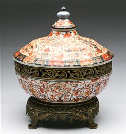 Sale 9175 - Lot 249 - A Large Imari Pattern Lidded Pot With brass Gilded Mounts And Base (H:41cm, Dia 33cm)
