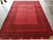 Sale 8485 - Lot 1021 - Afghan Turkoman Wool Carpet, with small guls on grid system, on a russet field (300 x 200cm)