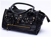 Sale 8921 - Lot 51 - A BURBERRY BLACK QUILTED LEATHER MANOR BAG; with gold tone hardware, padlock and key, rolled handles and quilted satin interior, 27...