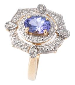 Sale 9124 - Lot 475 - A 9CT GOLD EDWARDIAN STYLE TANZANITE AND DIAMOND RING; centring an oval cut tanzanite within a double surround of round brilliant cu...