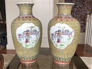 Sale 8815A - Lot 16 - A pair of Chinese polychrome vases with domestic scene cartouches over a yellow ground, H 44cm, markings to base