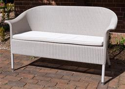 Sale 9248H - Lot 29 - A Cotswold Winter Lace two seat outdoor sofa in ivory with fitted cushion, by Vincent Shepperd.  Width 143cm