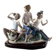 Sale 8000 - Lot 64 - A Lladro figural group of three boys eating fruit, printed and incised marks to base.