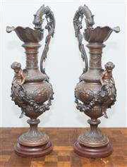 Sale 8338A - Lot 11 - A pair of Renaissance style cast metal ewers with fish handles and cherub caryatids holding festoons, H 65cm