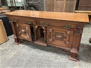 Sale 9068 - Lot 1019 - Late Victorian Oak Sideboard, with two frieze drawers, central columned niche, flanked by two cruciform panel doors, further flanked...