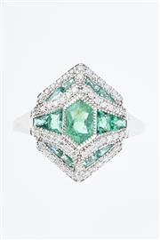 Sale 8299J - Lot 366 - AN 18CT WHITE GOLD EMERALD AND DIAMOND RING; centring a long hexagonal cut emerald surrounded by mixed cut emeralds and round brilli...