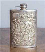 Sale 8650A - Lot 48 - An Indian or Sri Lankan silver hip flask chased with domestic and animal scenes, Height 13.5cm.