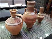 Sale 8657 - Lot 1033 - Set of 3 Terracotta Vessles