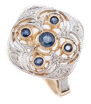 Sale 9074 - Lot 372 - A BELLE EPOCH STYLE SAPPHIRE AND DIAMOND RING; cushion form top with pierced quatrefoil motif set with 5 round cut blue sapphires su...