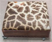 Sale 8261A - Lot 49 - A giraffe hide and leather upholstered ottoman, raised on industrial castors, H 33 D 70 W 76cm