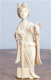 Sale 8650A - Lot 49 - A carved Japanese okimono of a female musician, Height 17cm.
