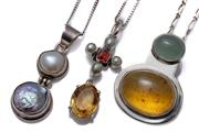 Sale 8999 - Lot 324 - THREE SILVER GEMSET PENDANT NECKLACES; one with 20.6 x 16.2mm oval cabochon amber and a cabochon chrysoprase, length 36mm on short a...
