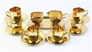 Sale 9003 - Lot 64 - Royal Winton gilt tea setting (one saucer cracked)