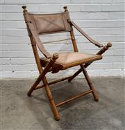 Sale 9085 - Lot 1085 - Simulated Bamboo Campaign Chair, by Prizmic & Brill, New York, with tan leather upholstery & strap armrests, on a folding X frame...