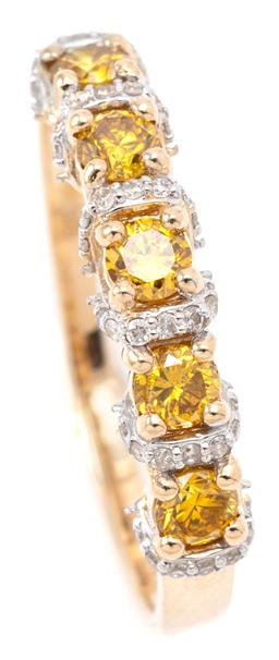 Sale 9164J - Lot 447 - A YELLOW AND WHITE DIAMOND RING; set in 9ct gold across the top with 5 round brilliant cut treated yellow diamonds totalling approx....