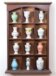 Sale 8515A - Lot 51 - An oak open display case of diminutive size, 47cm displaying Japanese porcelain calendar jars, together with one other (23 pot total)
