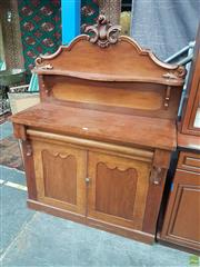 Sale 8576 - Lot 1065 - Victorian Mahogany Chiffonier, the carved back with cantilever shelf, long drawer & two panel doors