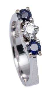 Sale 9020 - Lot 392 - AN 18CT WHITE GOLD SAPPHIRE AND DIAMOND RING; centring a round brilliant cut diamond of approx. 0.24ct P1, adjacent to 2 round cut b...