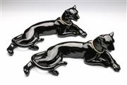 Sale 9086 - Lot 53 - Pair of reclining black panthers in the art deco style, signed H.D. Amers (l:47cm)