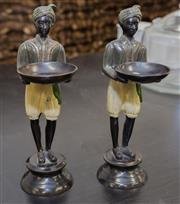 Sale 8310A - Lot 127 - A pair of blackamoor figures with offering bowls (one a/f) height each 27cm