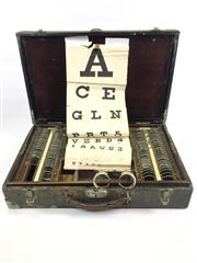 Sale 8539M - Lot 128 - Good Optometrists Travel Kit incl. vintage eye chart and spectacles. With velvet and wooden interior. 51cm x 33cm. Inscribed E. A. M...