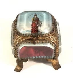 Sale 9142A - Lot 5032 - C19thFrench Relic Box, with Saint Anne dAurey on cover: cut glass and metal, with inner red silk lining, h.6.5, w.6.5 x d.6.5cm -