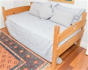 Sale 8308A - Lot 245 - A country pine single bed with heart detail, with mattress