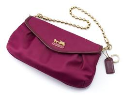 Sale 9132 - Lot 356 - A COACH FUSCHIA EVENING BAG, magenta sateen with patent leather trim, gold tone hardware and bobble link chain and gem style fob, in...