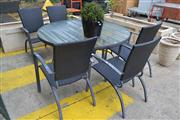Sale 8175 - Lot 1042 - 7-Piece Poolside Setting incl. Large Circular Glass Top Table & 6 Wicker Armchairs with Cushions