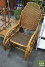 Sale 8299 - Lot 1059 - Cane Rocking Chair with Rattan Back and Seat