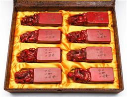 Sale 9144 - Lot 245 - Cased set of the eight immortals on chicken blood seals (H:12cm W:3.5cm D:3.5cm)