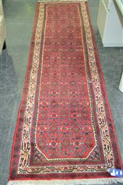 Sale 8050B - Lot 21 - Probably Persian Ingelas wool runner, with red field and cream border (277 x 77cm)