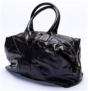 Sale 8921 - Lot 23 - AN YVES SAINT LAURENT BLACK PATENT LEATHER EASY Y  BOSTON BAG; Y design with double zips and hardware in silver tone, polished cotto...