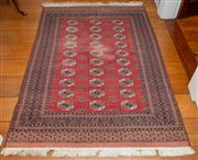 Sale 8595A - Lot 2 - A Pakistani Bokhara wool carpet with three columns of medallions, 180 x 122cm, some wear to pile