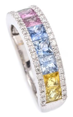 Sale 9164J - Lot 489 - A 9CT WHITE GOLD RAINBOW SAPPHIRE AND DIAMOND RING; 6mm wide band channel set with 9 carre cut treated yellow, blue, purple and gree...