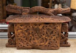 Sale 9160H - Lot 164 - A carved Indonesian/Timorese rice box or bread bin, with an alligator top and seated figures to sides, Height 47cm x Width 71cm x De...
