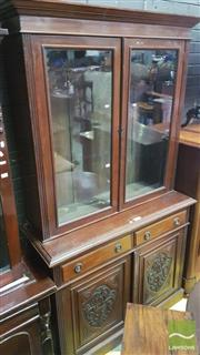 Sale 8345 - Lot 1088 - Late Victorian Walnut Bookcase, with two glass panel doors, two drawers & two carved panel doors (Key In Office)