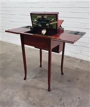 Sale 9068 - Lot 1042 - Edwardian Mahogany Mechanical Desk, the hinged top revealing a pop-up stationery compartment, a tooled green leather writing surface...