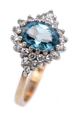 Sale 9194 - Lot 517 - A VINTAGE TOPAZ AND DIAMOND RING; multiclaw set with an oval cut blue topaz to surround and shoulders set with 22 single cut diamond...