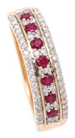 Sale 9132 - Lot 594 - A RUBY AND DIAMOND RING; 5mm wide band half hoop set with 7 round cut rubies and 16 round brilliant cut diamonds flanked by rows of...