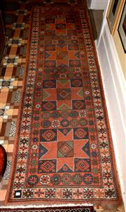 Sale 8080A - Lot 63 - A Turkish tribal wool runner with four star medallions.