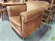 Sale 8495F - Lot 1075 - Brown Upholstered Armchair on Castors - tear to outer left arm