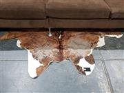 Sale 8765 - Lot 1041 - Brown and White Cow Hide