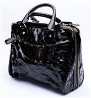 Sale 8921 - Lot 61 - A BALLY QUILTED BLACK PATENT LEATHER SHOULDER BAG; with gold tone hardware padlock and 2 keys, luggage tag and double full opening z...